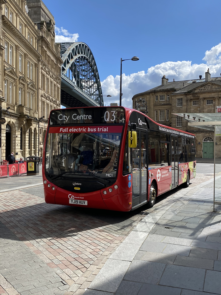 Electric bus with the Tyne Bridge in the background