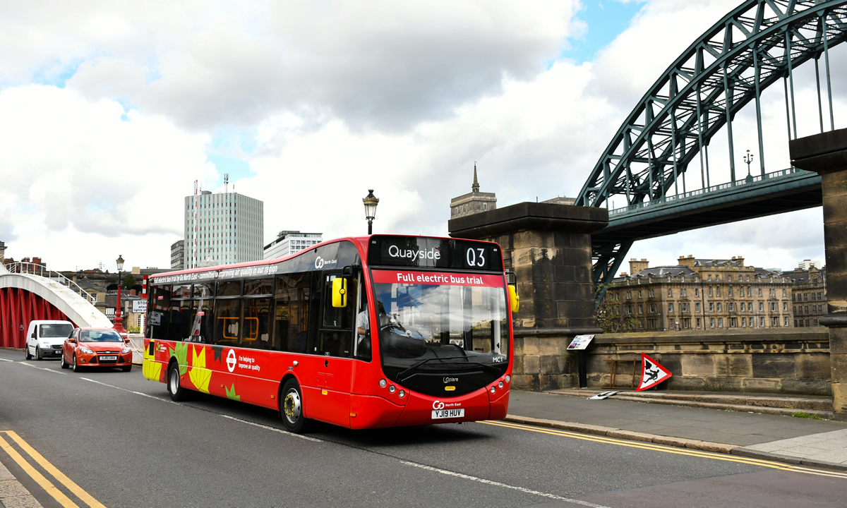 Electric bus crossing Swing Bridge with the Tyne Bridge in the background