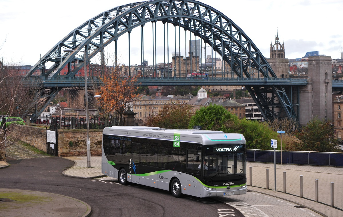 Voltra bus with Tyne Bridge in background